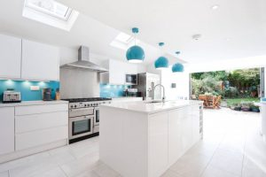 contemporary white cabinet blue pendant skylight blue backsplash window ceiling large window