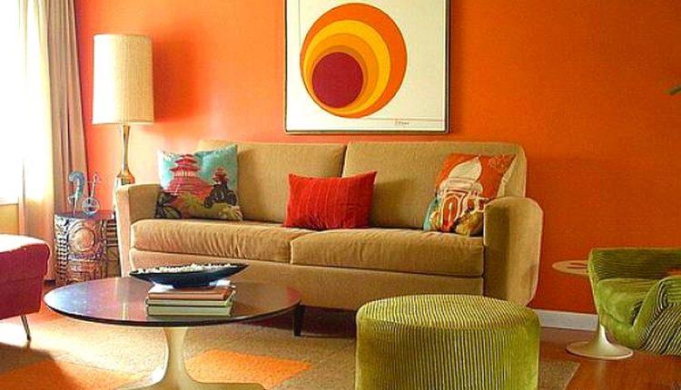 cream with yellow undertone sofa mini sized decorative pillows light green side table round top coffee table orange cream rug