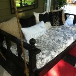 Dark Brown Wooden Bed Swing With Brown And White Pillow