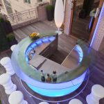 Glass Outdoor Wet Bar With Attractive Lamps Inside And White Unique Short Stools
