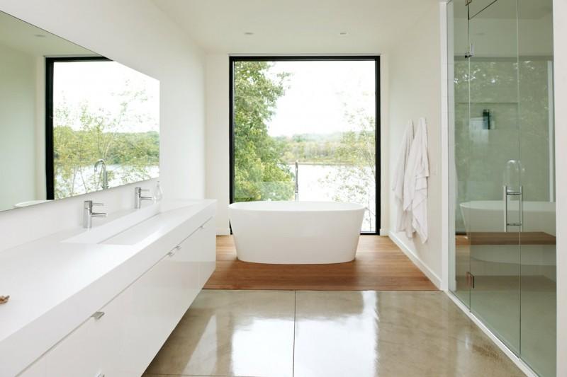 glass wall reflecting mirror wall undermount sink modern white cabinet free standing oval bathtub