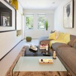 Grey Sofa With Yellow Decorative Pillows Soft Fury Rug White Glass Top Coffee Table