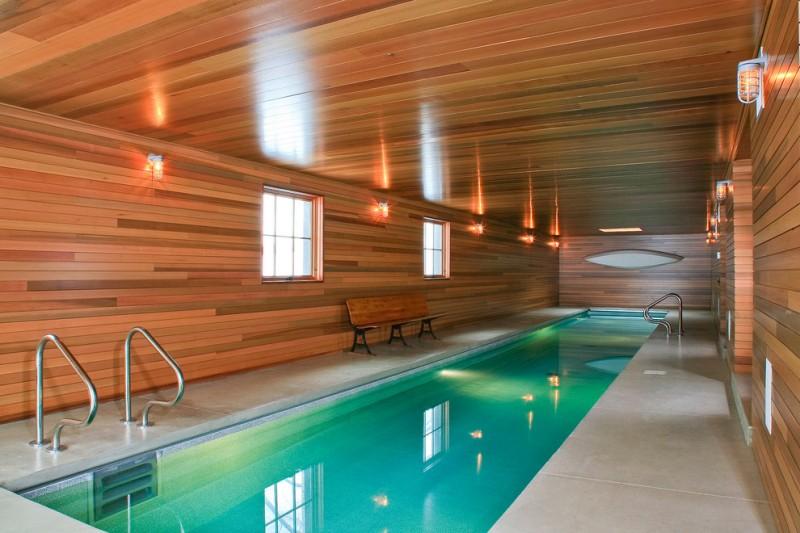 indoor lap pool modern lights long pool poolside bench wooden walls wooden ceiling