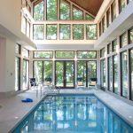 Indoor Pool Wooden Ceiling Poolside Chairs White Walls Glass Windows Glass Doors Mini Indoor Pool