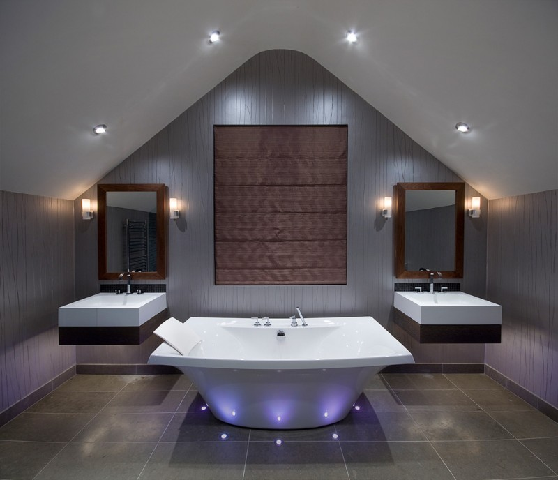 large brown white high end plumbing fixtures with tub and two sinks