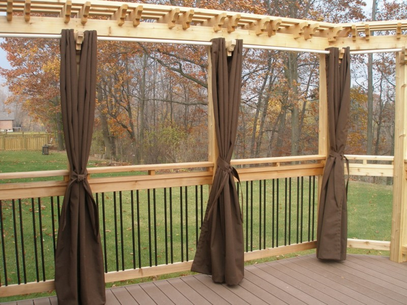 light brown railing with black metal and curtains