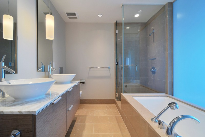 master bathroom layouts bathtub faucet floor tile basins cabinet toilet towel rack hanging lamp ceiling lamp glass door