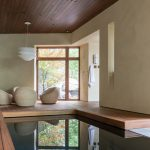 Mini Indoor Pool White Walls Towel Rack Poolside Seating Modern Light Wooden Floor Wooden Ceiling