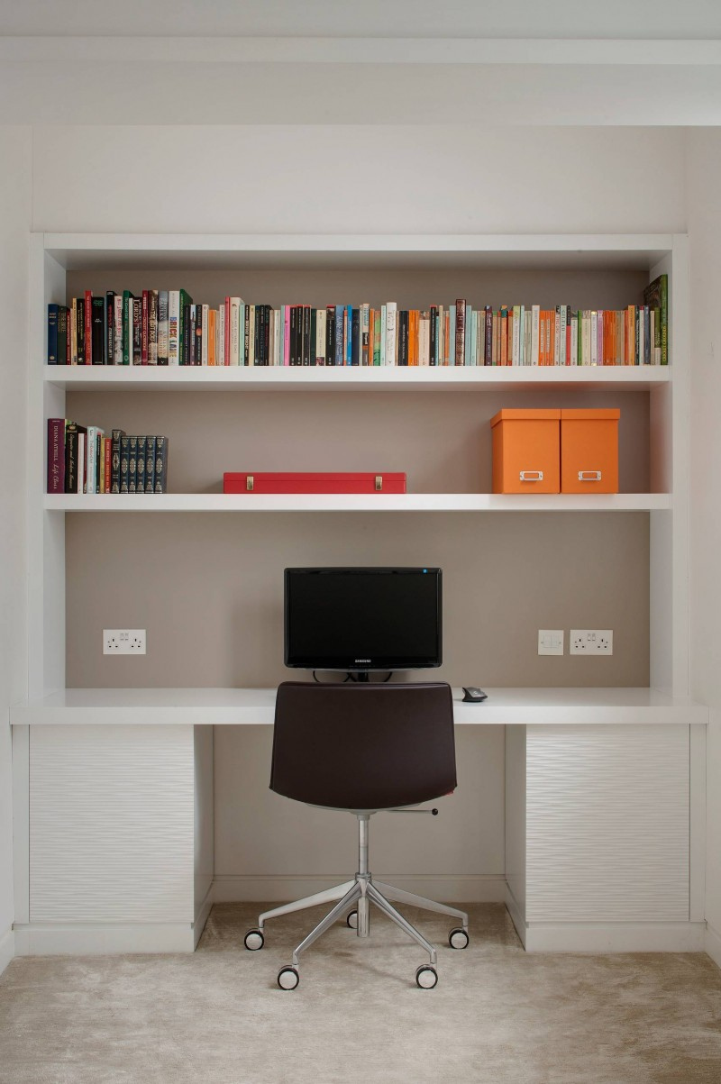 minimalist built in bookshelves white cabinet contrasted grey wall custom office chair