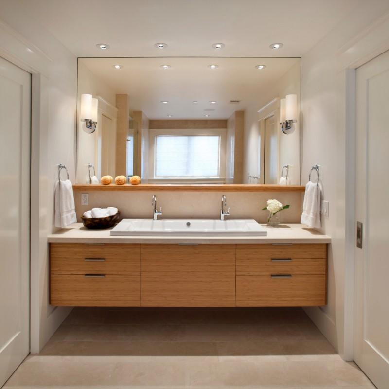 modern bathroom lighting mirror countertop wooden cabinet towel rack white door ceiling lamps faucet