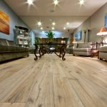 Modern Wide Living Room Wooden Floor Ceiling Lights Paintings Elegant Sofas Table With Classic Design