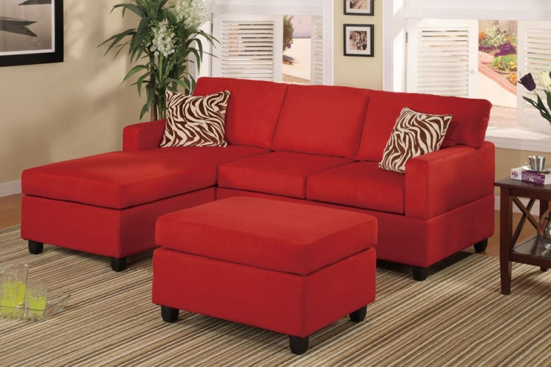 red sectional for small space with zebra pattern pillow and ottoman