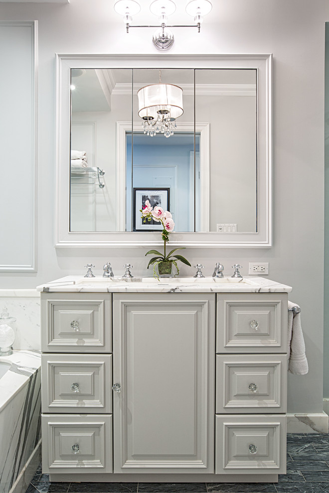 small bathroom remodels white cabinet drawer bright lamps faucets sink towel rack mirror