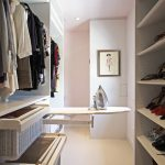 Small Closet Vertical With Rattan Drawers And Ironing Table