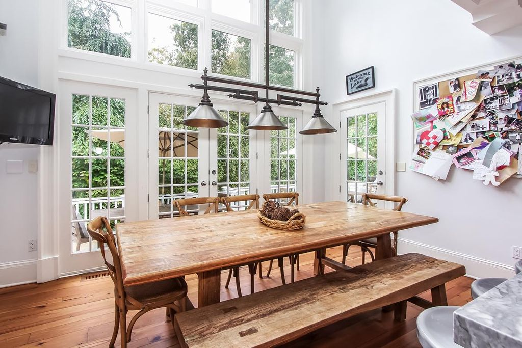 Traditional Dining Room With Table And French Doors