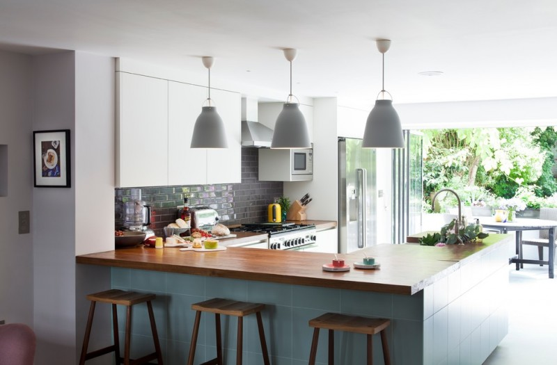 u shaped kitchen pendant lights faucet stove dining chairs table toaster painting cooking knives glass door