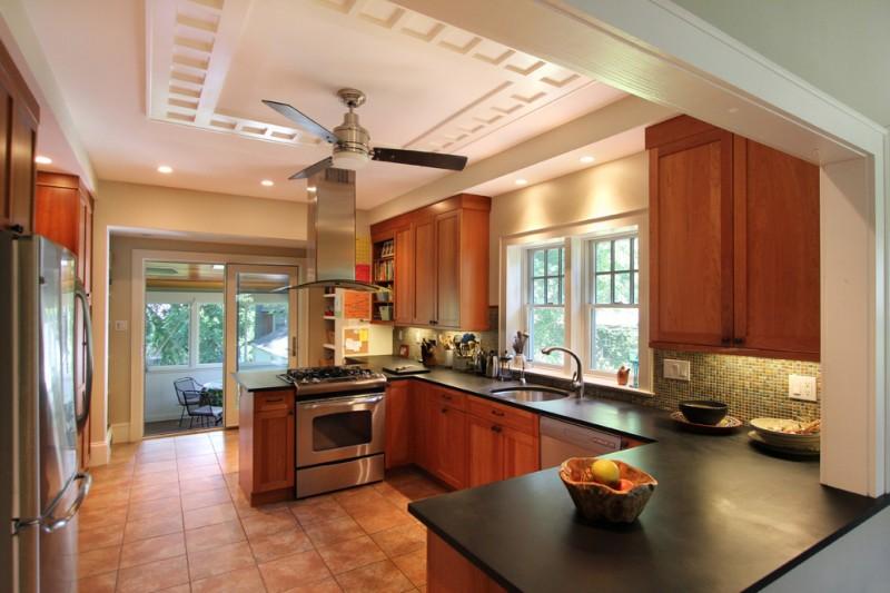u shaped kitchen wall cabinet wood brown floor ceiling fan faucet sink stove window ceiling lamp