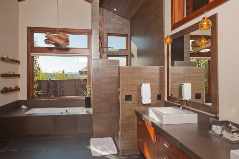 undermount bathtub brown pendant lights doorless shower space glass window black floor tiles