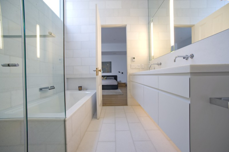 white bathroom ideas faucet sink wall tile modern lamp bed pillows door glass mirrors bathtub