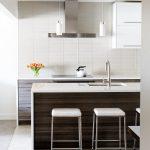 White Glassy Tiled Backsplash Upper White Cabinet Height Dark Wooden Cabinet Elegant Minimalist Lights