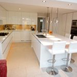 White Glossy Kitchen Islands With Handleless Units And Seat For 4