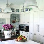 White Kitchen Brick Walls Pendant Lights Flowers Stove Faucet Wall Rack Wall Cabinet Marble Countertop