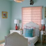 White Linen With Coral And Turquoise Pillows And Comforter