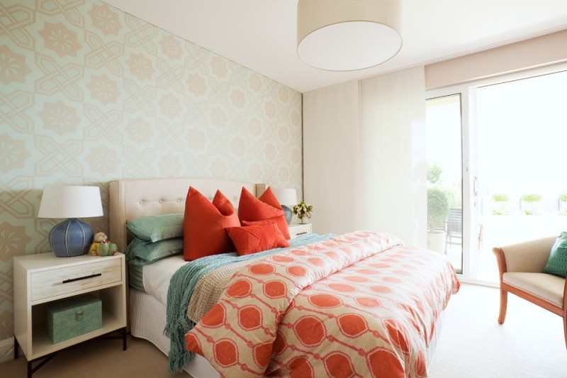 white linen with coral and turquoise pillows and coral circle patterned comforter