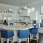 White Marble Countertop Round Kitchen Island With 4 White Chair With Blue Covers And Cushions