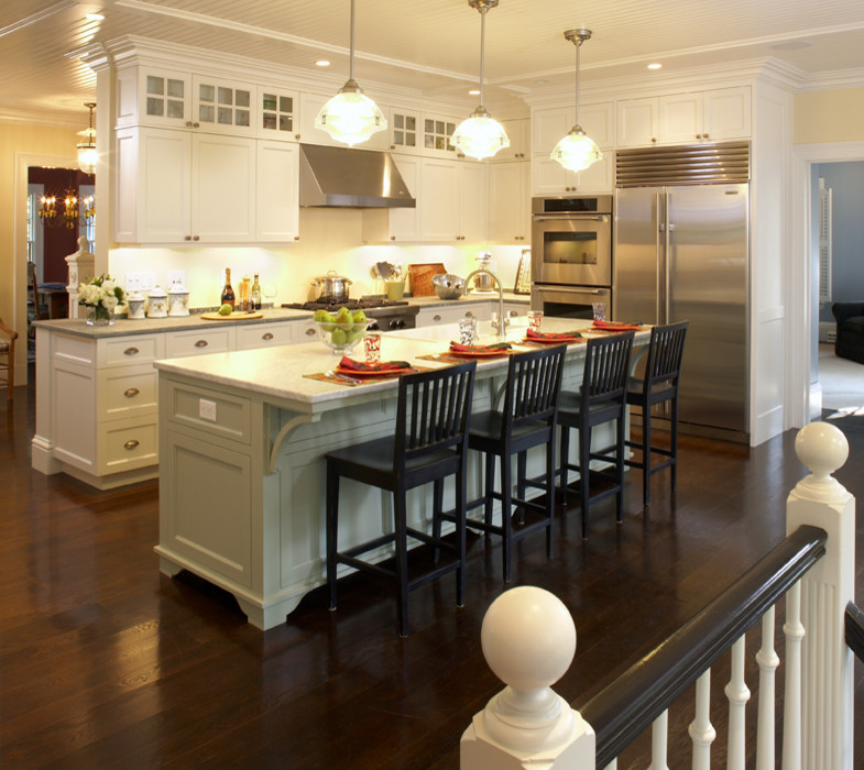 white marble countertop with white cabinet kitchen island with 4 dark brown seats
