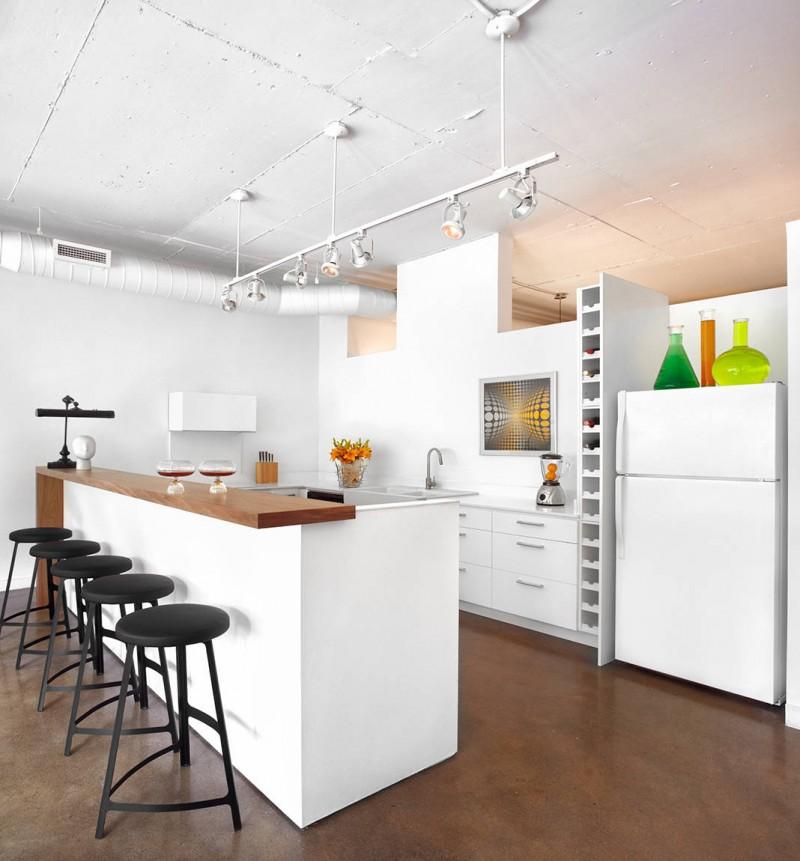 wooden top cabinet flat panel white cabinet u shaped white cabinet tracking lights long white wine storage black bar stools