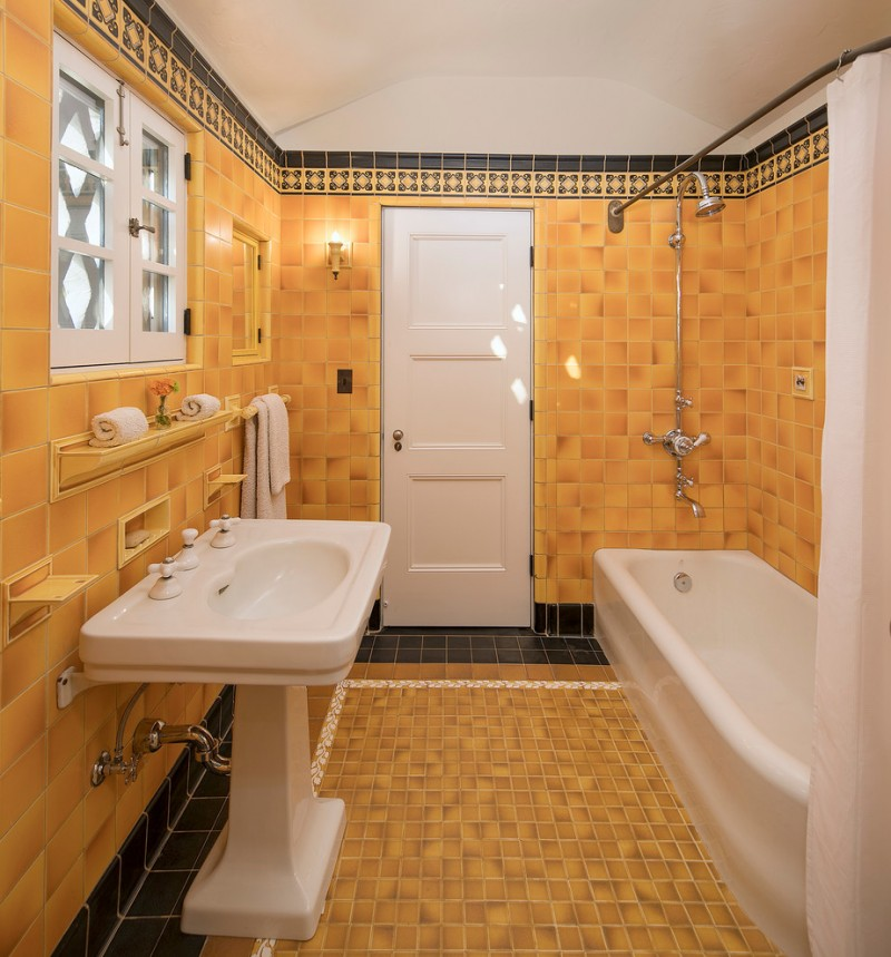 American Encaustic tiles for bathroom walls and floors in yellow free standing traditional vanity in white white bathtubs white craftsmanship door panel