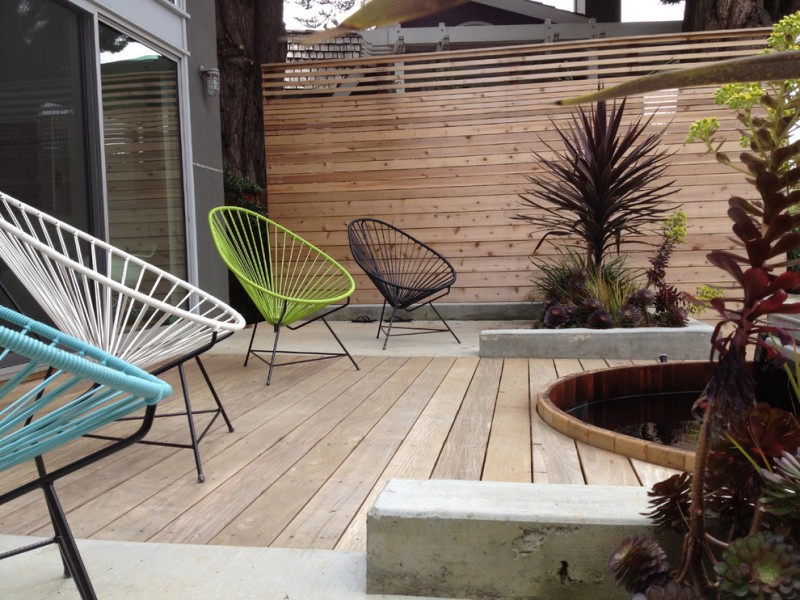 Contemporary back yard idea with dominant exterior woods several modern outdoor chairs in different color options