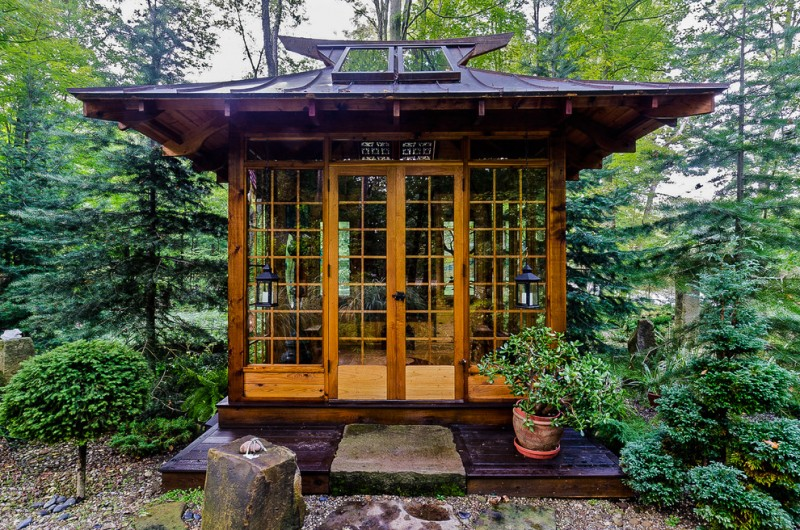 Japanase tea house design clear glass windows and door dark wood porch