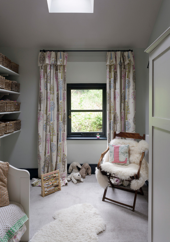Scandi patterned half curtains in full length glass window with black trims wall mounted shelves with basket storages chair with smooth &fury seater