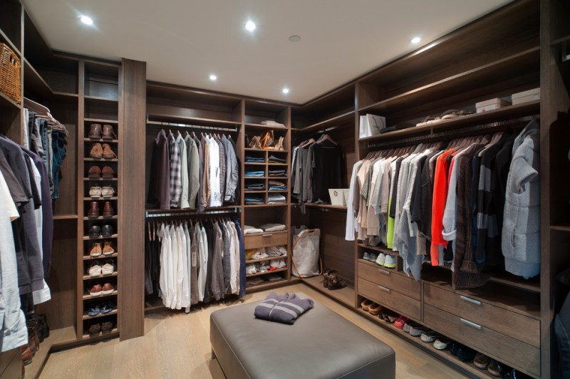 U shape walk in closet organizer for men which consists of hang sections open shelves open cabinets drawer system shoes shelving system flip flop storage