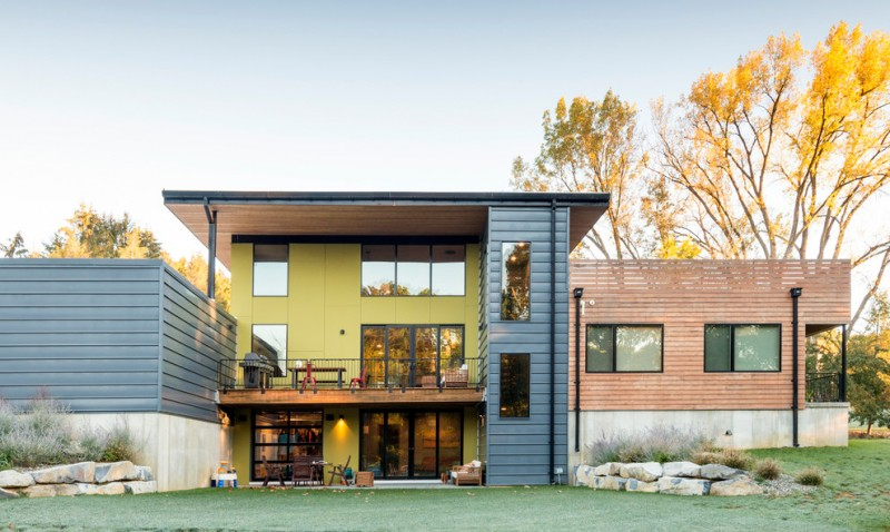 a trendy exterior house with mirror glass windows craftsman exterior materials green and blue wall finishings