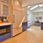Airy And Bright Gourmet Kitchen Design With Eating Area In Purple Theme Purple Kitchen Island With White Top Walk In Closet Storage With Purple Accent