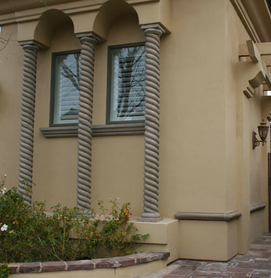 an exterior design with medium sized pillars and exterior glass windows