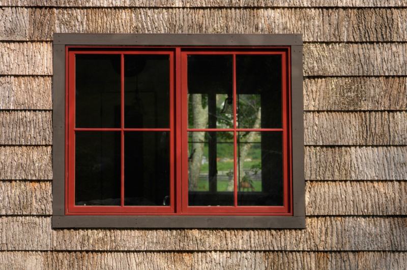 barkhouse exterior with hard and textured siding walls and double framed exterior window