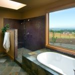 Bathroom With Walk In Showers Without Door With Mosaic Tiles Wall In Shower Room, Grey Tiles On Flooring, Green Tiles On Bathtub, Half Wall Partition To The Sink Area