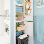 Bathroom With White Shower Bathtub Area, Blue Wall, White Wooden Cabinet