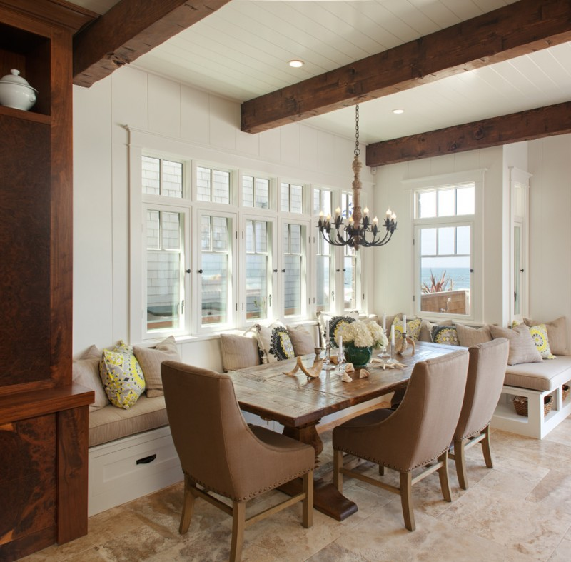beach style banquette set with white wall, white bench with brown cushion, brown pillows, brown chairs, square wooden table