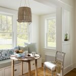 Beach Style Banquette Set With White Wall, White Chair, White Bench With Soft Blue, Brown Round Table, Rattan Lantern Lamp