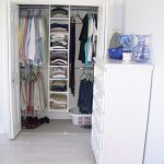 Bedroom Reach In Closet Design In White With Drawer System Addition