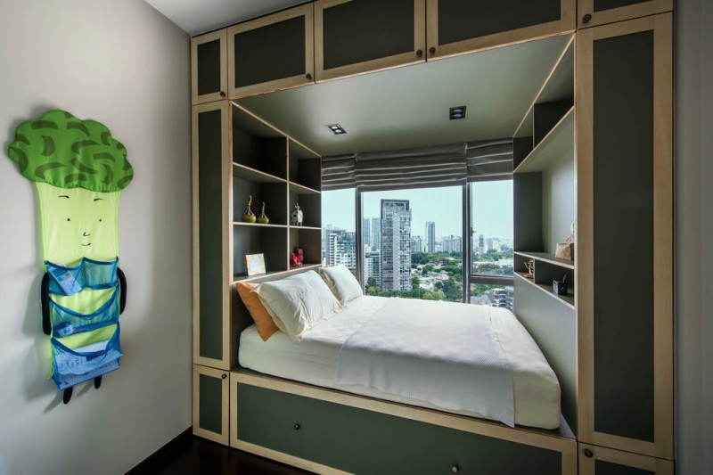 bedroom with shelves on head board and footboard, storage cabinet on top and under the bed