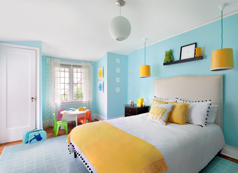 bedroom with soft bright blue wall, wooden flooring, light blue rug, white ceiling, white bedding, white yellow cover, yellow pendant lamp, white lantern, white table, colorful small chairs