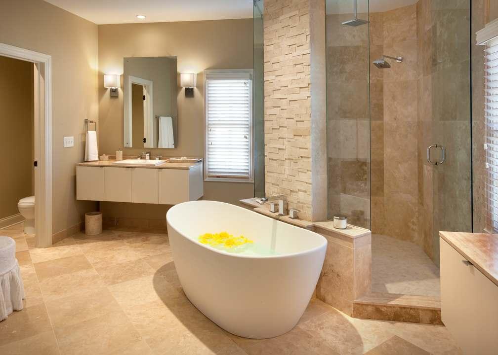 beige marble floor brick wall contemporary white free standing bathtub glass shower door floating vanity unit