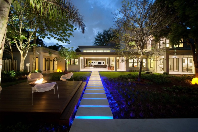 blue LED lighting under the floating steps from the yard to the building