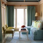 Blue Upholstered Corner Sofa With Green Chairs And White Wooden Table